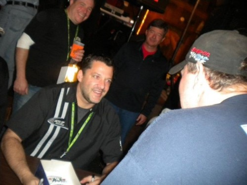 NASCAR Champion Tony Stewart takes part in an autograph session at Inlet's Old Barn Restaurant. Courtesy photo