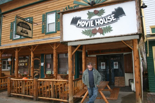 Brandon DiMartino stands in front of the Tamarack Movie House in Inlet, which he co-owns with his wife Megan. Photo by Carol Hansen