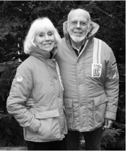Deke a nd Carol Morrison wearing their ski jackets from the 1980 Winter Olympics. Photo by Michele deCamp