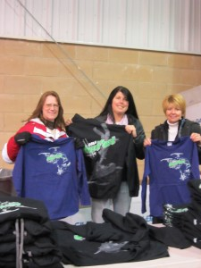 Windy Kelley, Laurie Barkauskas, and Sandy Booton show off this year's Snofest shirts. Photo by Dana Armington