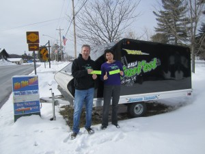 Laurie Barkauskas and Nick Bankert sport Snofest shirts and tickets by this year's Snofest Raffle prize.