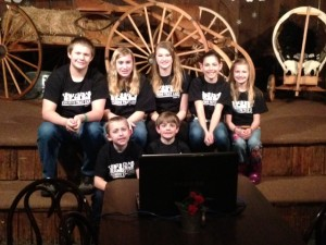 Inlet's Cousins That Care, back row, from left, Shawn Hansen, Shelby Townsend, Founder Melanie Levi, Britney Levi. Front Row, Cory hansen, Thomas Levi. Couputer in foreground waiting to Skype.