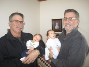 Uncle Mark Parent, left, holding Connor, and father Martin Parent with Cooper