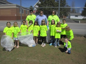 Town of Webb first grade students picked up trash on the athletic field for Community Pride Day, with Brandon McGrath, Jed Kinney and Bonnie Tracy. Photo by Wende Carr