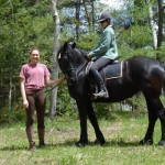 Anne Phinney on horseback with her riding student Lauren Holt. Michele deCamp photo