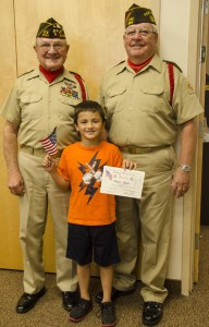 Second grader Dominic Aliasso with Jim Tilley and Bill Ransom
