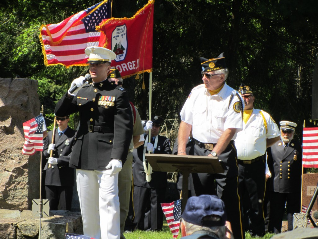 Capat. Christopher Simpson, USMC, addressed the audience at Riverview Cemetery in Old Forge. His father, Commander Bill Simpson is at his left. Photo by Kaycie Lawson