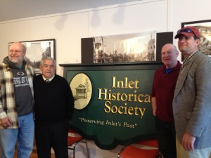 Standing with the Inlet Historical Society's new sign are, from left, Past President Charlie Herr, Board Member Waddie Kalil, current President Craig Wittlin, Vice President Mitch Lee. Courtesy photo.