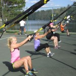 Joann Malys TRX class at the Old Forge tennis courts.