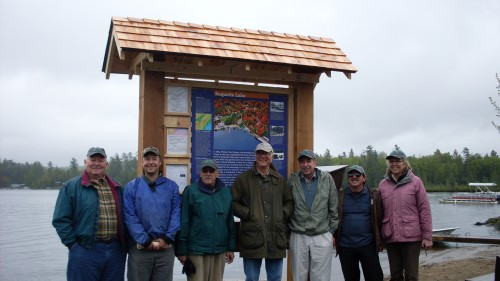 Lined up in front of the Raquette Lake kiosk are, from left, Jim Kammer, Walter Oposzynski, Alan Bennett, Jeffery Sellon, John Sammon, and Kevin & Sue Norris