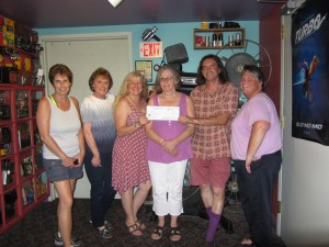 Strand owners Helen Zyma, third from left, and Bob Card received a $3,000 donation for the theater's digital converstion from Old Forge Fire Dept. Auxiliary member Carol Perkins, Joanne Widman, Jane Tormey and Barb Winslow. Photo by Gina Greco