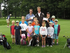 Scholarship winners Colin Chris and Lexie Haehl and Thendara Golf Pro Rich Chapman (back row, from left) with participants in the 2013 Junior Golf Camps. Missing from photo is Scholarship winner Bryan Townsend