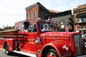 A scene from last year's Fire Fighters Drill School parade in Old Forge Photo by Carol Hansen