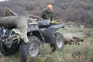 Brother Bob with my mule deer and elk in tow.