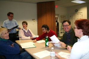Director Alan Saban, standing, and some of the cast members of Paula Roy's reader's theater play, from left, Carol Hansen, Karen Lee, David Beck, Stephen Wick and Kelly Hamlin. Photo by Isabella Worthen
