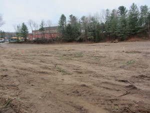 Housing development land having been cleared at the old lumber yard site in Old Forge, just below the Strand Theatre on Route 28. Photo by Gina Greco