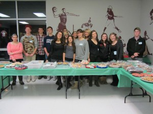 """Some of the cast members of """"Annie Get Your Gun"""" held a fundraising bake sale Thursday night at Webb school. They are, from left, A. DiOrio, C. BNarkauskas, W. Lamphear, T. Fenton, R. Smith, V. Franco, C. Simpson, L. Beal, S. Delmarsh, M. Rice, L. Rubyor, N. Redpath, L. Payne, A. Brosemer, M. Payne, B. Palmer. Photo by Gina Greco"""