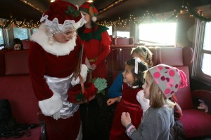 Mrs. Claus greets cousins Terra and Gabrielle Montanye on the Adirondack Scenic Railroad train.