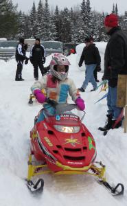 Chloe Clark races a Polaris 120 for Clark Energy of Eagle Bay