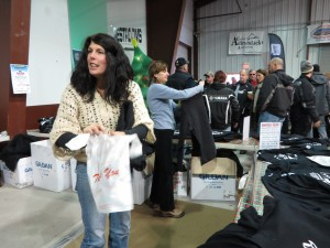Laurie Barkauskas, left, and Elise LaGrange selling Snodeo T's and sweatshirts