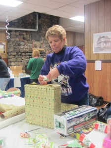 Lisa Lloyd wraps a present for the Kiwanis Christmas For Kids Project Photo by Gina Greco