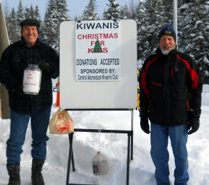 Kiwanis Members Fred Trimbach, left, and Bill Baumann offer the collection container to Snodeo visitors. Courtesy photo