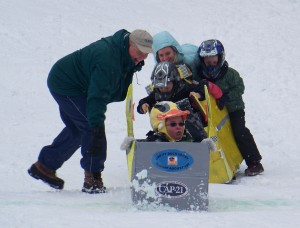 Inlet Supervisor John Frey helps some some cardboard sled racers at last year's Frozen Fire & Lights.