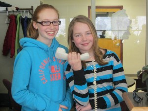 Fifth grade students S. Rowe and M. Prichard offered some hints as to the theme of this year's PARP Program during school announcements on Wednesday, February 26th. Photo by Gina Greco