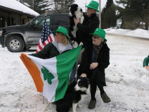O'Waiting on the Parade: Dawn Schweinsberg, Patty Foley, Chip Kiefer, and faux Irish Setters, Thatcher and Zona. Photo by Gina Greco
