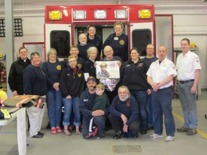 Front row:Chris and Gage Stanley, Leo DeVincenzi. Second row: Father Shane Lynch, Barb Winslow, Mary Henry, Mary Roach, Hanson Schmid, Peg Masters, Danny Rivet, Anne Rundell, Matt Hipkens, Chief Charlie Bogardus, Ron Parent. Back Row: Dave Langworthy, Kathy DeVincenzi and Terry Lehnen. Photo by Gina Greco