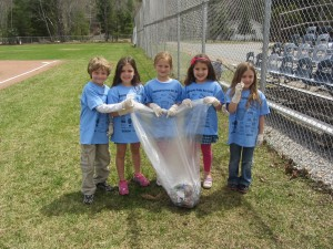 Mrs. Mitchell's first graders were among the Town of Webb UFSD students that helped clean their environment for Wednesday's Community Pride Day; some of them were, from left, G. DuGuay, H. Masters, R. Lis, L. Little, and K. Howard. Photo by Gina Greco