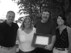 Kent Massacar, Town of Webb DPW, holds his Certificate of Appreciation, flanked by CAA President Kelly Greene, CAA Event Coordinator Laurie Barkauskus, and Mike Farmer.