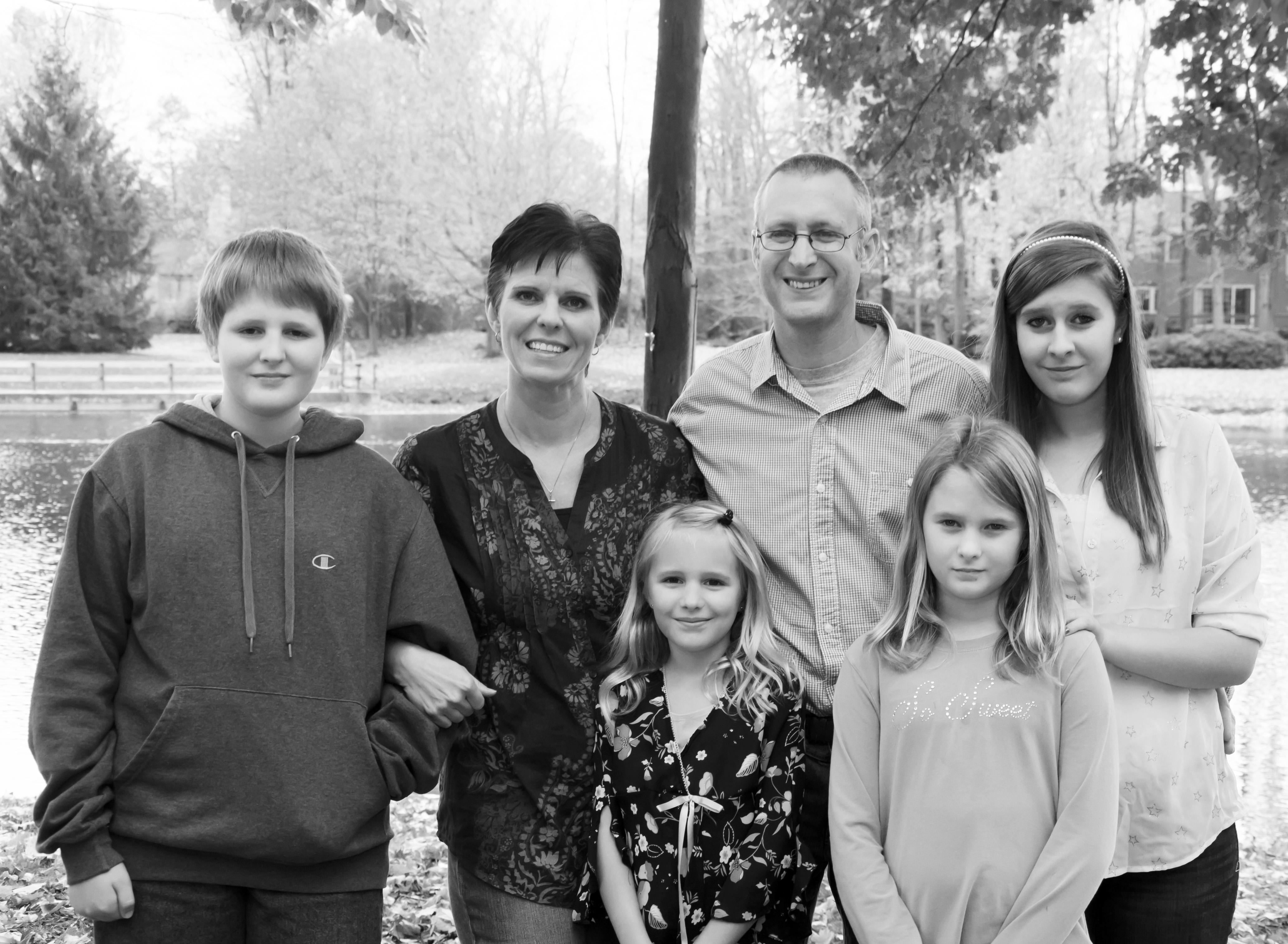 Pastor Phil Huber, his wife, Sue, and children, Carissa, Amanda,