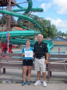 Katie (Noonan) Wojdyla and Tim Noonan, owners of Enchanted Forest Water Safari, with their Travelers Choice water park award.  Photo by Gina Greco