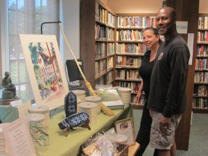 Anne and John Moore check out auction items on display for Sunday's Old Forge Library Bash. Photo by Gina Greco