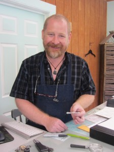 Ken Thibado displays his custom-designed  OneSquare Mile  of Hope brooch.  Photos by Gina Greco