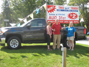Otter Lake Fire Dept. Ladies Auxiliary member Julie Eisenhart hands the truck keys to winners Allen and Mary Sundberg. Courtesy photo