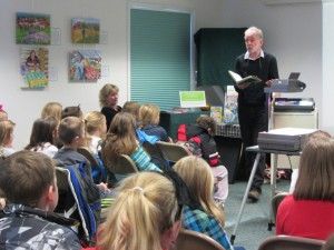 Gary VanRiper spoke to kindergarten through sixth grade students on November 20 with his wife Carol (seated). The pair who author and illustrate the Adirondack Kids book series with their son Justin, explained the process of creating and publishing children's books. Photo by Gina Greco