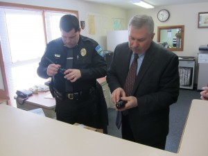 Town of Webb Police Chief Ron Johnston (left) and Herkimer County Sheriff Chris Farber assembling the P25 radios. Photo by Gina Greco