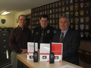 Town of Webb Supervisor Ted Riehle (from left), Town of Webb Police Chief Ron Johnston, and Herkimer County Sheriff Chris Farber with the new MiFi routers and P25 radios. Photo by Gina Greco