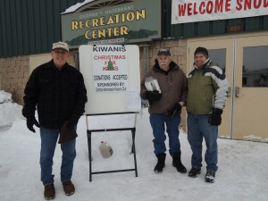 Fred Trimbach, Bob Stanton and Chuck Trimbach offer the collection container to Snodeo visitors. Courtesy photo