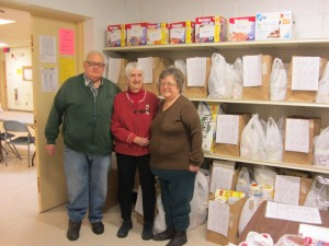 Jim Zurakowski, Charlotte Pylman and Joann Zurakowski in front of the new and improved Food Pantry system at St. Bartholomew's Church. Photo by Gina Greco