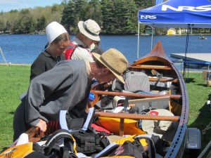 Visitors examine a boat at Mountainman's 2014 Paddlefest.  Photo by Gina Greco