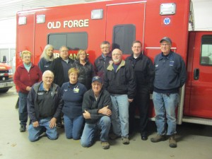 Some of Old Forge's Emergency Services Volunteers: Kneeling, from left, are Dan Rivet, Linda Salin, and Richard Risley. Back row, Terry Lehnen, Peg Masters, Dave and Jeanette Berkstresser, Ron Leszyk, Dave Langworthy, Father Shane, and Mike Senf. Photo by Gina Greco