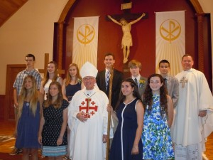 Confirmation Class front row, Chloe Barkauskas, Alexandra DiOrio, Bishop LaValley, Robin Smith, Sydney Payne Back: Aaron Nerschook, Mackenzie Kelly, Shelby Townsend, Carter Kelly, Brendan Kelly, Erik Lenci, and Father Shane Lynch