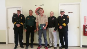 From left: Scott Cornell, Woodgate Fire Department Asst. Chief; Tom Rothdiener, CNYFA; Tyler McGough; Brian McQueen, FASNY; Tony Sege, Woodgate Fire Department Chief. Courtesy photo