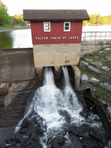 The dam at the Old Forge Pond outlet releasing four cubic feet of water per second during the current season of low water.