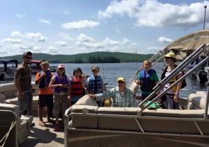 Fishing guide Nate Clague, R. Lutz, G. Heath, T. Levi, M. Trumbauer, Lorraine Fay, C. Hansen, and Chri Holt