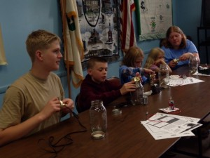 """Making lamps,"" from left, are James Luck Jr., Collin Bick, Elorah and Keturah Luck and 4-H Volunteer Melonie Luck."