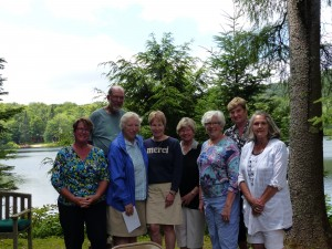 Perennial Favorites...Founding members of the Old Forge Garden Club were among the guests at a 10-year celebration luncheon at the home of John and Pat Tappan. Maureen Kantor, Gary Lee, Lynn Otto, Bette Rintrona, Loretta Kaye, President Pat Johnston, Past President and First President Pat Tappan, and Mary Hofer. Photo by Michele deCamp